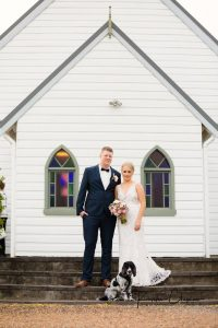 Hannah & Dylan & Hugo Furbaby in front of the Lovedale Wedding Chapel in the Hunter Valley