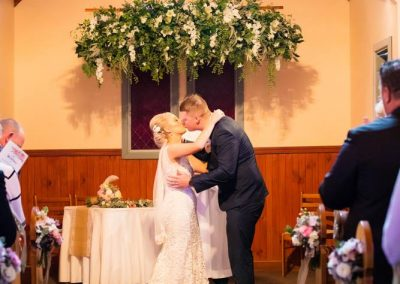 Hannah & Dylan under our new & very pretty Flower Garland